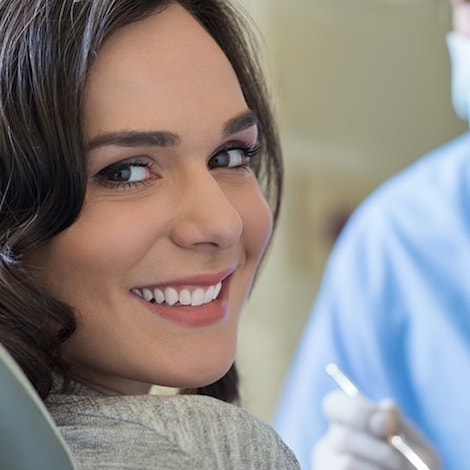 Shot of a woman smiling at the camera in Franklin New Patients