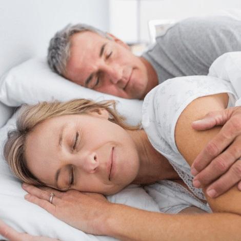 A couple sleeping peacefuly thanks to sleep apnea treatment.