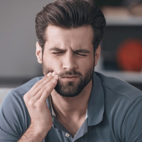 Man with a tooth problem so he turns to TMJ treatment.